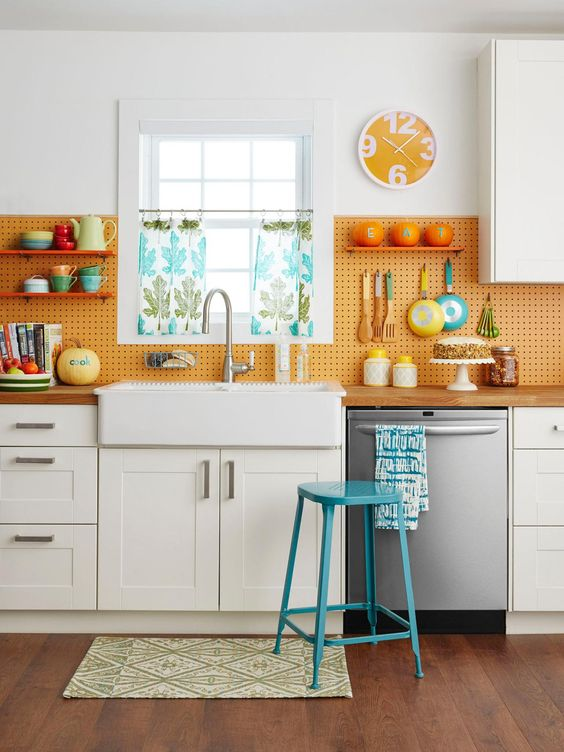 a pegboard backsplash is a creative idea that allows accomodating a lot of things