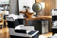 09 a traditional wingback chair in black and white stripes for a vintage and rustic interior