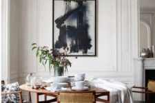 09 a vintage space with a mid-century modern dining set and art