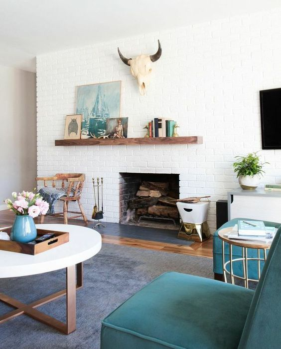 an asymmetrically attached mantel accents the fireplace and the arrangement on it