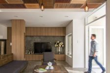 09 catchy wood tiles on the ceiling of earthy colors become a showstopper here