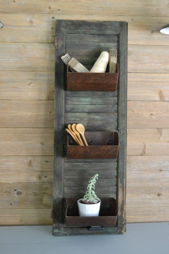 farmhouse storage shutter with old loaf pans for a vintage feel in your kitchen is a unique DIY project
