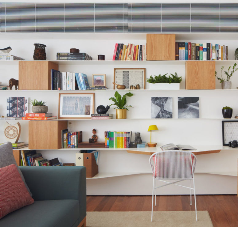 This shelving comprises a home office or reading nook, which is perfectly integrated into decor