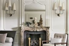 10 a creamy living room with molding, an antique fireplace and edgy designer's furniture and lamps