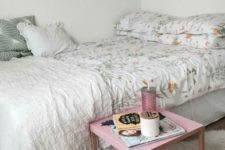 10 a large bed takes the whole space, and a small nightstand is all you need to add