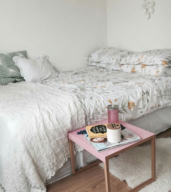 a large bed takes the whole space, and a small nightstand is all you need to add