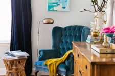 10 a teal tufted velvet chair is a great fit for a modern boho space like this one