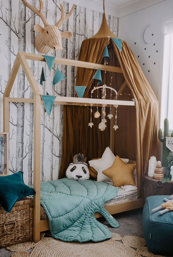 a beautiful forest-inspired kids' room with an unique bed is lively yet not too bright, with a perfect balance