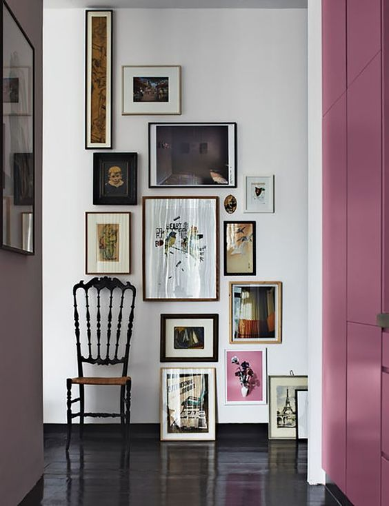 a bold asymmetrical art wall is a great way to accent the space and make it unique