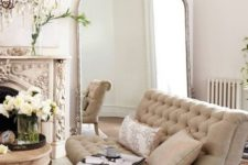 11 a refined Parisian interior in neutral shades with gilded touches
