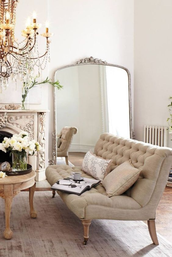 a refined Parisian interior in neutral shades with gilded touches