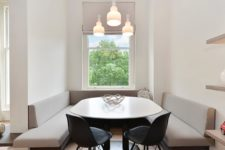 11 a tiny dining space features built-in banquettes and a rounded table that don't make the space feel small