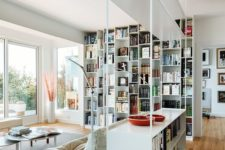 11 an airy metal shelving unit with open and box shelves looks very contemporary