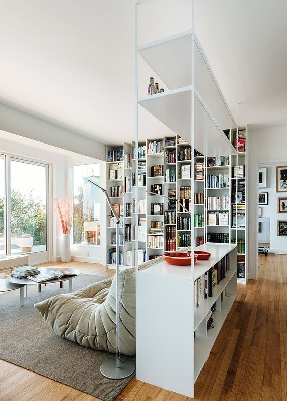 an airy metal shelving unit with open and box shelves looks very contemporary