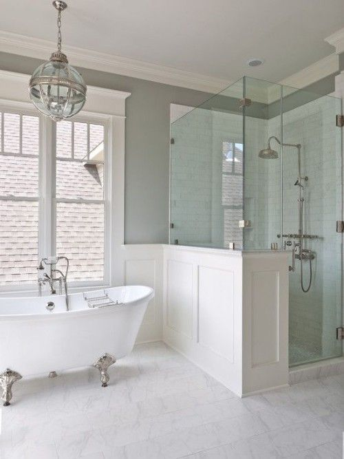 this vintage space is made more welcoming and cozy with wainscoting, which also divides the spaces