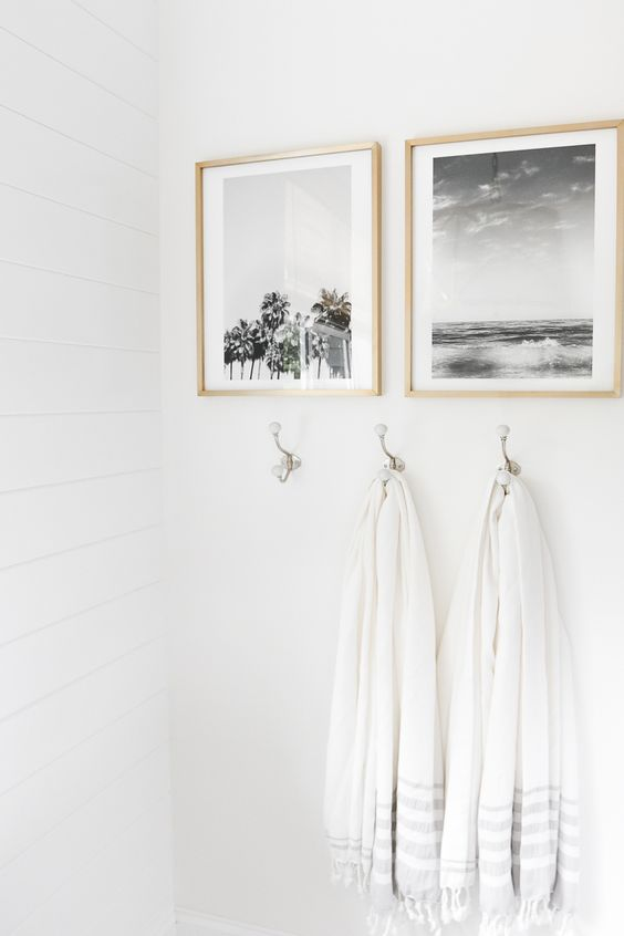 your personal photos in frames can be used to decorate a bathroom and make it cozier
