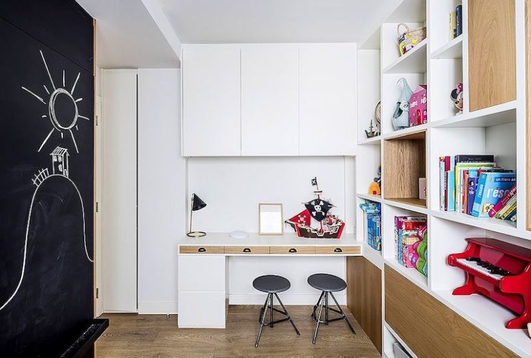 The second kids' space features a chalkboard and lots of storage shelves plus a space for creating