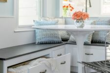 12 a cozy breakfast nook with a built-in corner bench with storage is a perfect solution