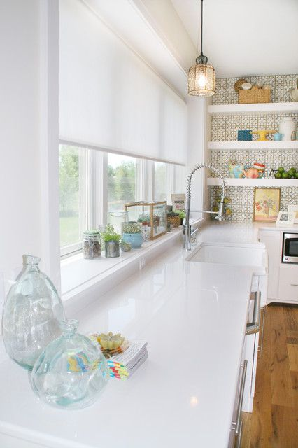 a semi sheer white Roman shade is an ideal solution for a kitchen or a bathroom