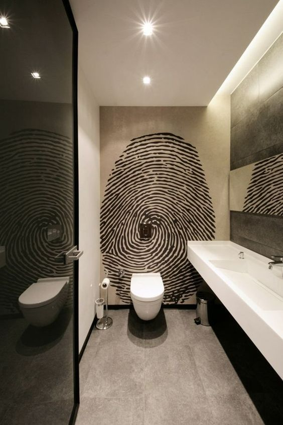 an oversized graphic fingerprint wall art is sure to add a personalized touch to the masculine space