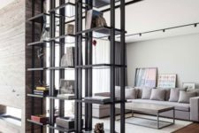 12 black metal open shelving divides a living room and a dining space and looks lightweight