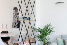 13 a catchy geometric shelf can hold some items and separate the dining and living spaces subtly