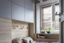 13 a small bedroom with built-in storage and a built-in bed with increased functionality