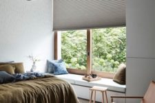 13 a textural Roman shade adds interest to the bedroom while keeping it private enough
