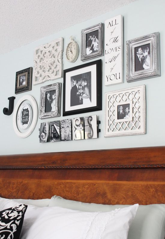 a vintage-inspired gallery wall with personal photos and signs