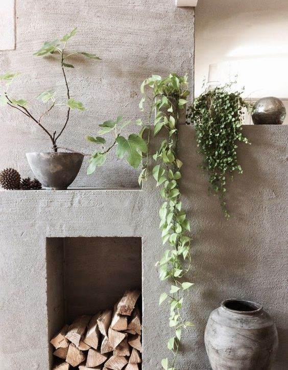 enliven the concrete fireplace with climbing plants hanging from the mantel