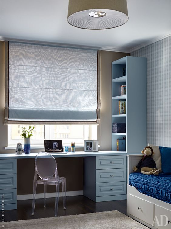 a calming and peaceful space in various shades of grey and blue is ideal not only for boys but also for girls