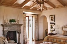 14 a coffered wooden ceiling makes this refined bedroom complete and brings warmth to the space
