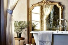 14 a gorgeous floor mirror in a vintage frame adds an accent and perfectly fits the rustic space