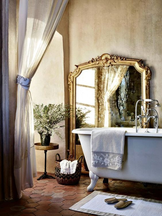 a gorgeous floor mirror in a vintage frame adds an accent and perfectly fits the rustic space