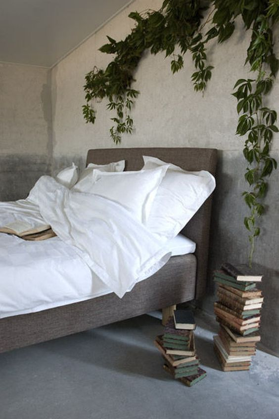 a lush climbing plant over the bed enlivens the space and makes it fresh and bold