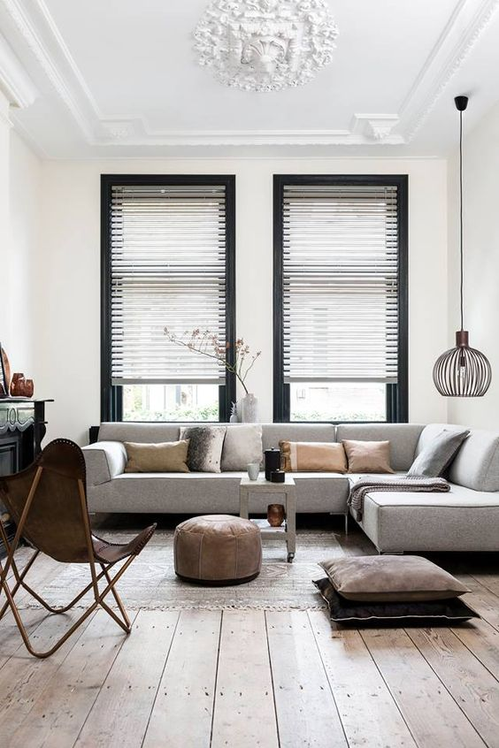 dove grey L-shaped sofa perfectly fits the room decor bringing that contemporary feel to the space