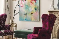 15 a couple of very bold and colorful upholstered wingback chairs and a bold artwork make the nook vibrant