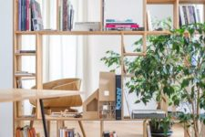 15 a creative geometric plywood bookshelf separates two spaces and doesn't look bulky