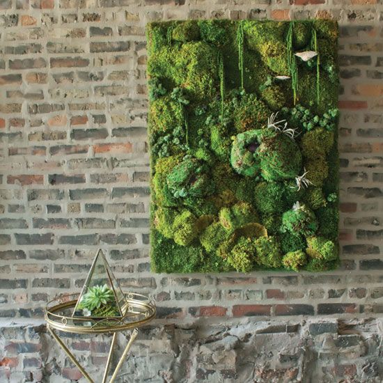 a textural moss wall art with various shapes for more eye catchiness and bold look