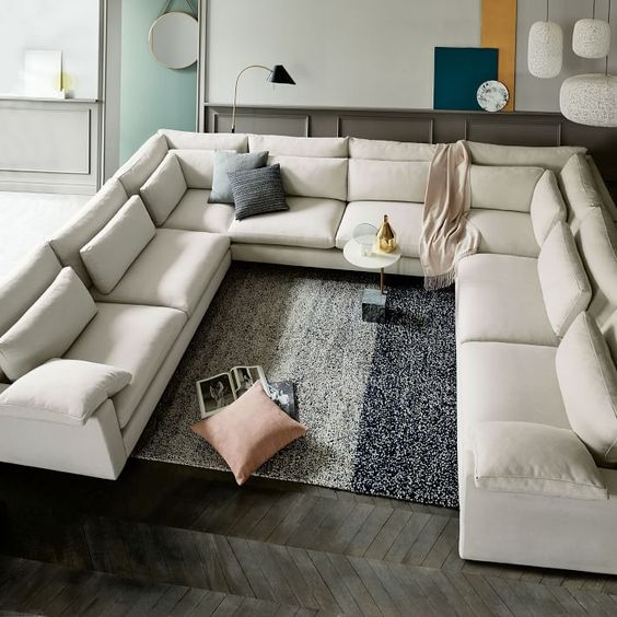 An Oversized Creamy U Shaped Sectional Sofa Is A Great Conversation Pit  Base To Go