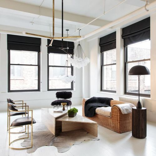 black touches here add interest and Roman shades in black are among these eye-catchy items