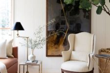 16 a creamy wingback adds a chic and elegant touch to the space and is a comfy furniture piece
