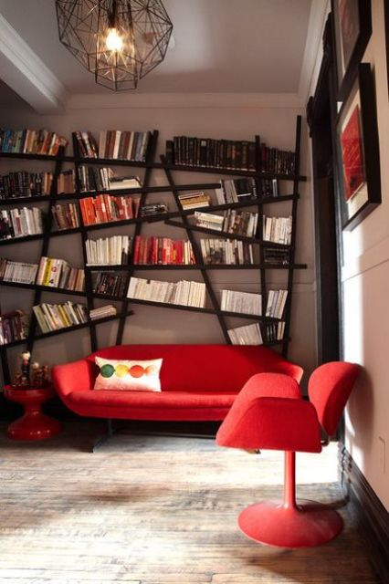 a large asymmetrical bookshelf that takes the whole wall is a bold feature that makes you drop your jaw