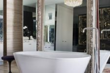 16 a whole mirror wall with an additional vintage mirror and a gorgeous statement chandelier for a refined feel