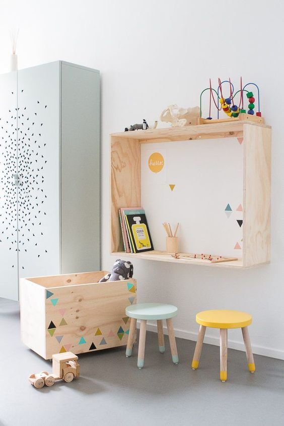 colorful toys, stools and geometric prints on the furniture and wall add a lively touch