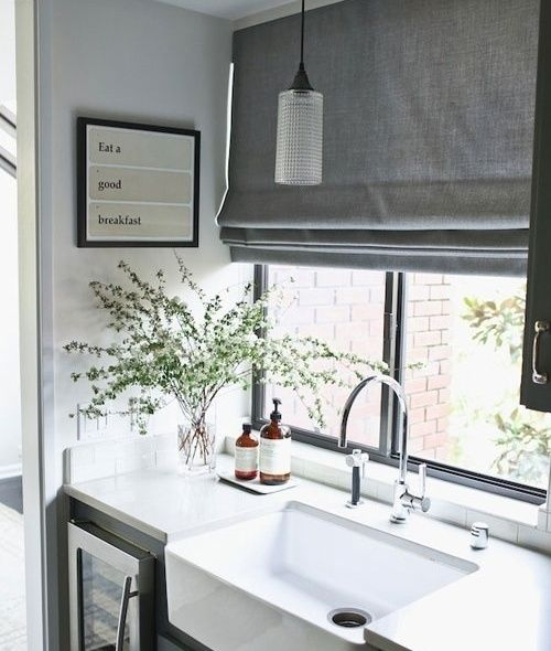 grey Roman curtains are a perfect fit for a Scandinavian kitchen