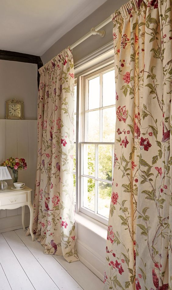ivory curtains with fuchsia and green floral prints add a refined vintage feel to the space