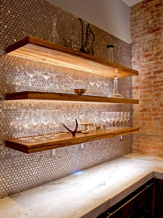 a copper penny tile backsplash and lit shelves for the home bar space