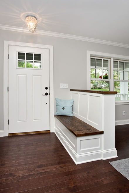 a farmhouse-styled pony wall with an entryway bench and a wooden countertop