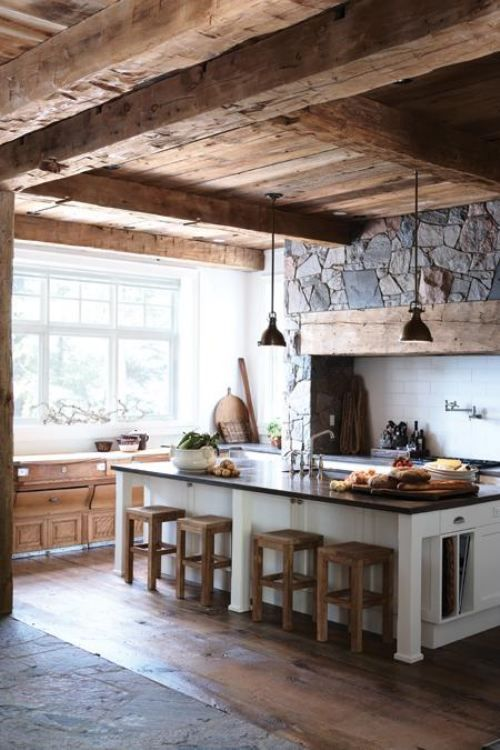 kitchen with a stone clad wall